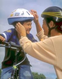 Mother and son wearing bike helmets